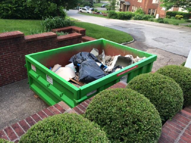 dumpster outside a house