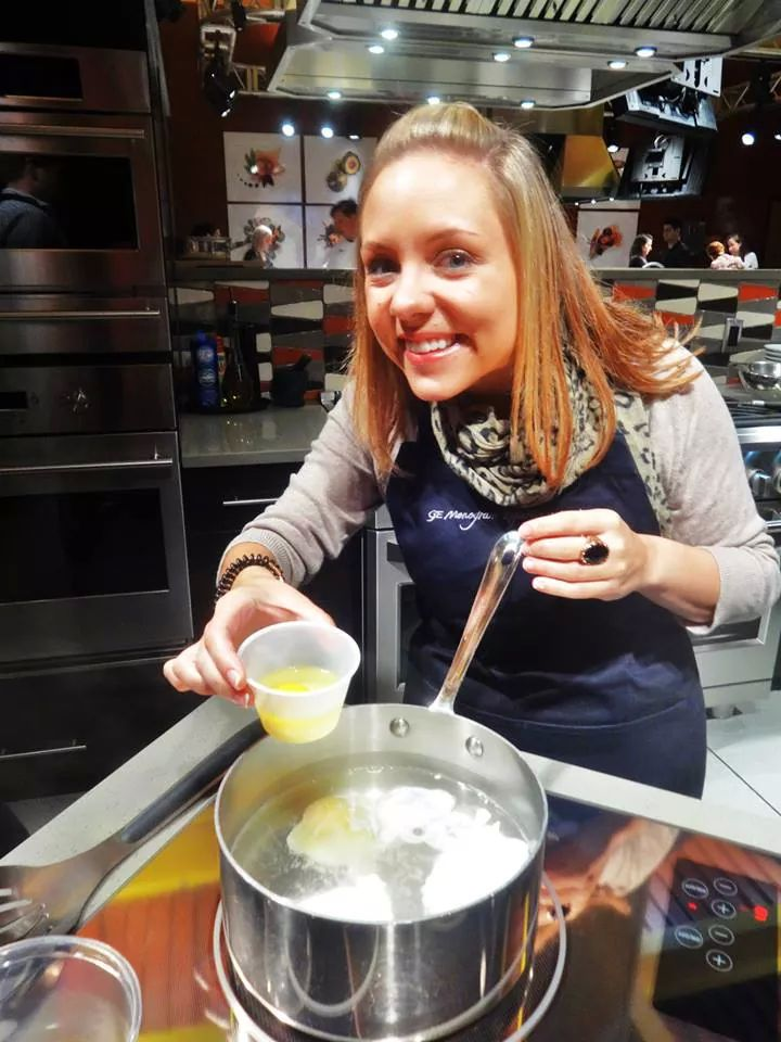 Kristin having fun cooking in the GE Monogram Experience Center in Louisville, KY