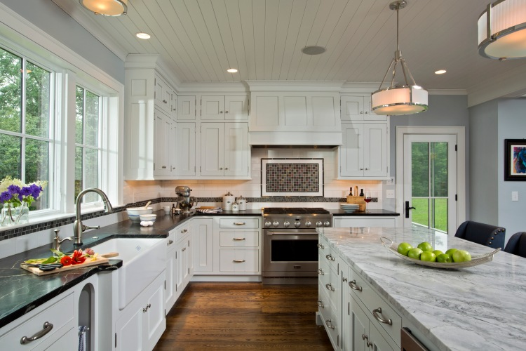 An elegant and impressive open kitchen designed by Eva Anderson featuring Monogram appliances.